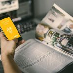 Browsing Magazine with iPhone Mockup – Freebie Download