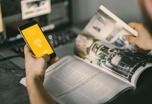 Browsing Magazine with iPhone Mockup – Freebie Download