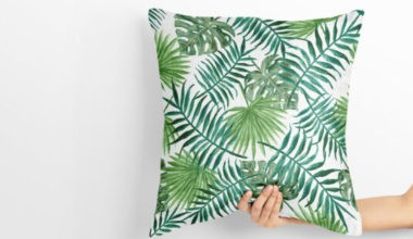Hand holding a Pillow Free Mockup