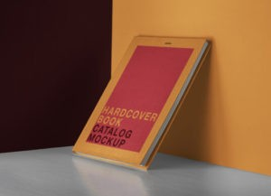 Hardcover Book leaning against Wall Free Mockup