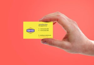 Holding Business Card Free Mockup