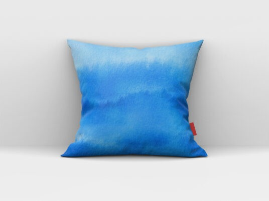 Square Pillow leaning against Wall Free Mockup