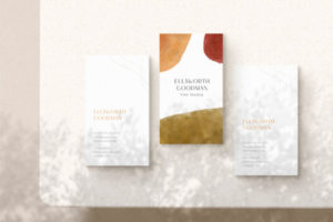 Three Business Cards on a Table Free Mockup