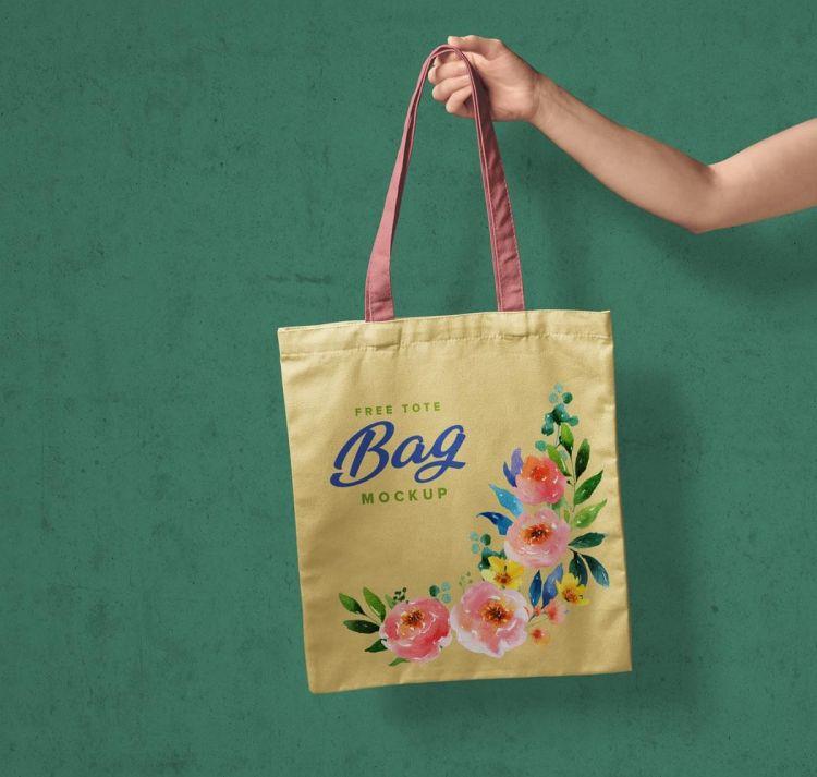 Free Hand Holding Tote Shopping Bag Mockup