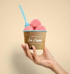 Free Ice Cream Cup in Hand Mockup (PSD)