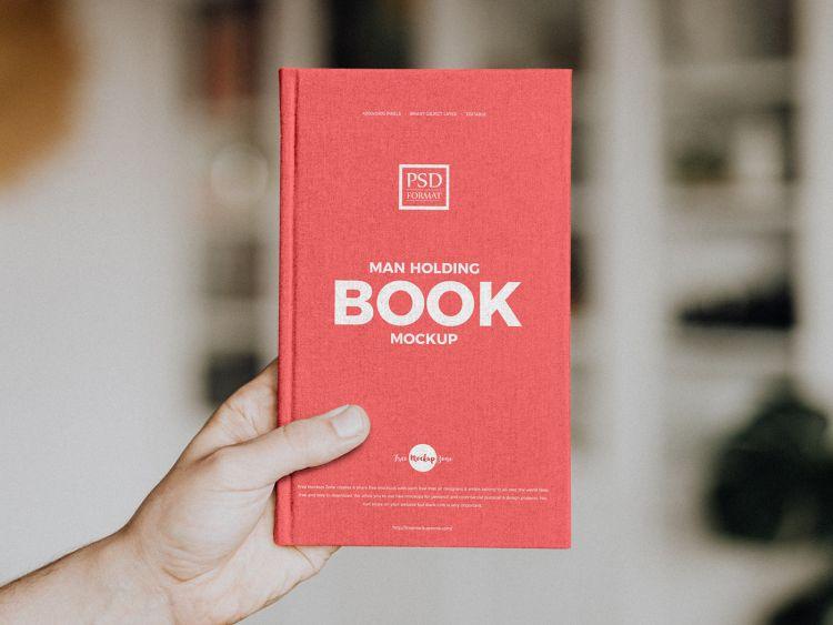 Free Holding Book Mockup (PSD)