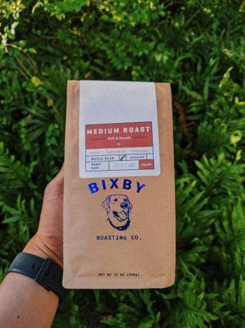 Holding Coffee Bag Free Mockup