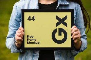 Woman Holding Poster Frame Free Mockup