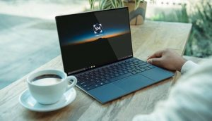 Free Realistic Laptop on Desk Mockup