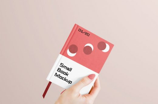 Holding Small Book Free Mockup