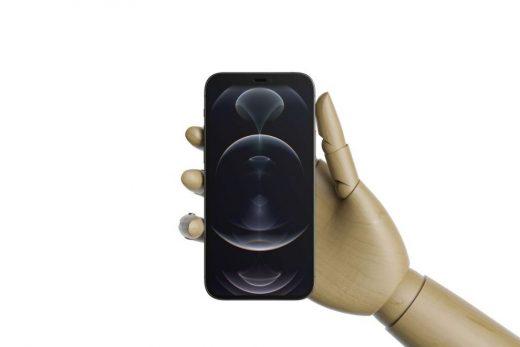 Holding iPhone 12 Pro Free Mockup