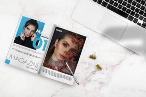 Opened Magazine on Desk Free Mockup