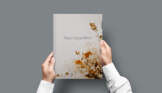 Folder in Hand Free Mockup
